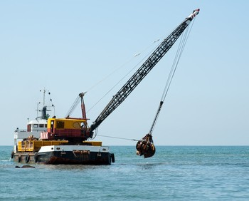 Barge dredging a harbor